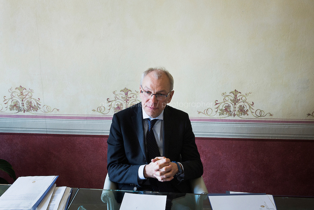 SIENA, ITALY - 20 MARCH 2015:  Marcello Clarich (57), President of the Monte dei Paschi di Siena Foundation, is interviewed at Palazzo Sansedoni (headquarters of the foundation) in Siena, Italy, on March 20th 2015. <br /> <br /> The charitable Monte dei Paschi di Siena Foundation is the bank's largest shareholder that has financed projects in the fields of economic development, art and research. Until 2014, the Foundation has entirely funded Siena Biotech, a clinical-stage drug discovery company whose  efforts are mainly focused on discovering new drugs for therapeutic intervention against neurodegenerative diseases and in oncology, such as Alzheimer's Disease, Huntington's Disease and Cancer.<br /> <br /> Now Siena Biotech has filed for bankruptcy proceedings, and its researchers and employees occupied the headquarters of the company based in Siena.<br /> <br /> Siena, a Tuscan city and UNESCO World Heritage Site, is home to Monte dei Paschi di Siena, the world's oldest surviving bank and Italy's third largest bank. The bank, founded in 1472, was the largest employer in Siena, and it helped finance a host of community projects and services until it stumbled during the financial crisis started in 2008.