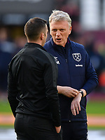 Football - 2019 / 2020 Premier League - West Ham United vs. Brighton & Hove Albion<br /> <br /> West Ham United manager David Moyes withReferee Michael Oliver, at The London Stadium.<br /> <br /> COLORSPORT/ASHLEY WESTERN