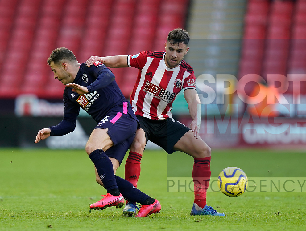 George Baldock of Sheffield Utd tackles Ryan Fraser of Bournemouth during the Premier League match at Bramall Lane, Sheffield. Picture date: 9th February 2020. Picture credit should read: Simon Bellis/Sportimage