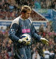 Photo: Glyn Thomas.<br />Aston Villa v West Bromwich Albion. The Barclays Premiership. 09/04/2006.<br /> West Brom's keeper Tomasz Kuszczak as the hailstones fall.