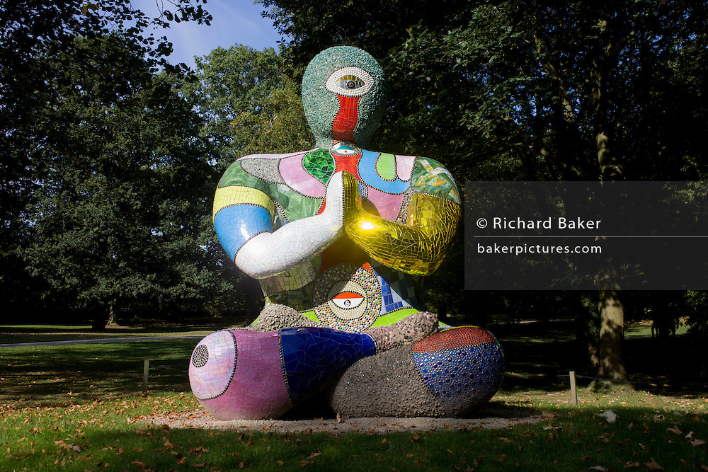 The Buddha (2000) by artist Niki de Saint Phalle in the grounds of the Yorkshire Sculpture Park. The sculpture is formed from a steel base covered in polyurethane foam. The surface is made from pieces of glass, mirror, ceramic tile and polished stones – termed 'M&Ms' by the artist.