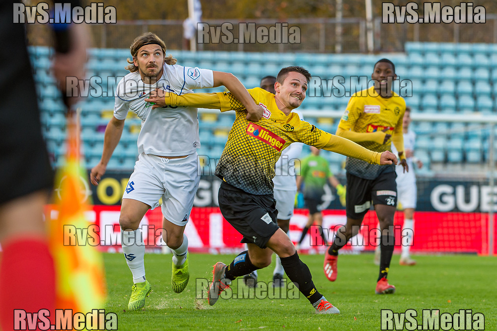 LAUSANNE, SWITZERLAND - NOVEMBER 10: #14 Alexandre Pasche of FC Lausanne-Sport battles for the ball with #19 Helios Sessolo of FC Schaffhausen during the Challenge League game between FC Lausanne-Sport and FC Schaffhausen at Stade Olympique de la Pontaise on November 10, 2019 in Lausanne, Switzerland. (Photo by Robert Hradil/RvS.Media)