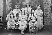 """9305-B7336. Six young Indian women in photo studio. Maids of The Dalles 1928. (from left) Kulchiat/Louise Lunie Andrews; Mildred Smith Tyler; Mary Ann Kelly Switzler; Linda """"Whiz"""" Spedis; Agnes Henry Jackson; and Katherie Smith Courtney. The Dalles, Oregon 1928"""