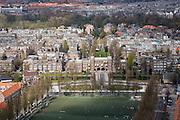 Nederland, Amsterdam, Olympiaplein, 16-04-2008; sportende scholieren op de sportvelden aan het Olympiaplein; daar achter het Amsterdams Lyceum aan het Valeriusplein met aan het water de Pieter Lastmankade (links) en de Jan van Goyenkade (rechts); het Vondelpark en Oud-West in de achtergrond; het multifunctionele sportveld is van kunstgras..luchtfoto (toeslag); aerial photo (additional fee required); .foto Siebe Swart / photo Siebe Swart