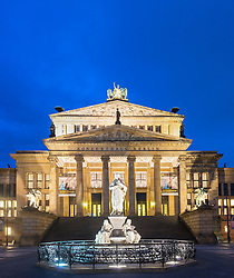 Historic Konzerthaus and Statue of Friedrich Schiller in Gendarmenmarkt square in Mitte Berlin Germany