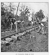 """Contraband laborers [Escaped Slaves] often pressed into service by Federals are repairing the """"stringer"""" track near Murfreesboro after the battle of Stone s River. from the book ' The Civil war through the camera ' hundreds of vivid photographs actually taken in Civil war times, sixteen reproductions in color of famous war paintings. The new text history by Henry W. Elson. A. complete illustrated history of the Civil war"""