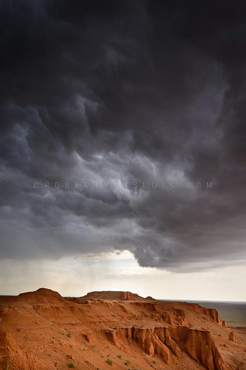 Storm clouds gathering at Bayanzag Flaming Cliffs, Mongolia. Photo © Robert van Sluis - www.robertvansluis.com