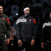 19 June 2012: Miami Heat power forward Chris Bosh (1), Miami Heat small forward LeBron James (6) and Miami Heat shooting guard Dwyane Wade (3) stand during the national anthem prior to the Miami Heat 104-98 victory over the Oklahoma City Thunder, in Game 4 of the 2012 NBA Finals, at the AmericanAirlinesArena, Miami, Florida, USA.