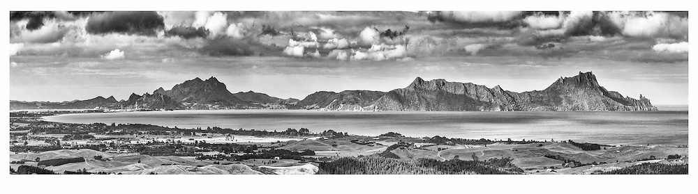 Home! <br /> Nothing beats that view as you come up and over the Brynderwyns!<br />  <br /> limited edition fine black and white art print, also available in colour. <br /> <br /> Print  $275 (900x220mm)<br /> Framed from: $590<br /> <br /> Framed 1.5m fine art print: $1499<br /> <br /> Floating canvas 1.5m (framed): $1250<br />  <br /> Larger print size are available easily to 1.8 metres in length!<br /> <br /> To order direct, contact Alan through the contact tab above or at info@alansquires.co.nz<br /> <br /> <br /> Available to view and purchase from my studio gallery or Goody Goody cafe Waipu (to view 2.2metre)The Bach in the town basin has 900x220mm prints - or from Alan's studio.