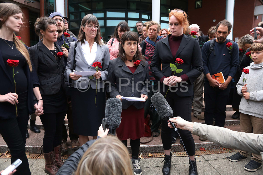 "Taryn, partner of Richard Loizou reads out a statement as a reaction to the sentence 26 September 2018, Preston crown court, United Kingdom. From left is Fern, Roscoes sister, partner of Roscoe Sarah, Rosalind, mother of Roscoe and Michellle, partner of Richard Roberts.  Simon Roscoe Blevins, 26,  Richard Roberts, 36 were both sentenced 16 months in prison, Richard Loizou, 31, sentenced 15 months in prison and  and Julian Brock, 47 12 months supended. Simon Roscoe Blevins, 26,  Richard Roberts, 36 were both sentenced 16 months in prison, Richard Loizou, 31, sentenced 15 months in prison and  and Julian Brock, 47 12 months supended. Simon Roscoe Blevins, 26,  Richard Loizou, 31, Richard Roberts, 36 and Julian Brock, 47 climbed on top of several trucks during a mass protest by locals and supporters in New Preston Road, against fracking in Lancashire, July 2017. The trucks were prevented form delivering equipment to Cuadrillas nearby fracking site for four days. After a seven day jury trial at Preston Crown Court in August 2018, the four men were found guilty of Public Nuisance. Judge Altham has told them to expect ""immediate custodial sentences"" on 25th September 2018."