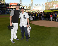 CHICAGO - JUNE 01:  Danny Farquhar #43 of the Chicago White Sox, who suffered a brain hemorrhage during a game  on April 20, 2018 against the Houston Astros, poses for a photo with Nate Jones after throwing out a ceremonial first pitch as his family, members of the RUSH University Medical Center team who treated him,  and his White Sox teammates look on prior to the game against the Milwaukee Brewers on June 1, 2018 at Guaranteed Rate Field in Chicago, Illinois.  (Photo by Ron Vesely)  Subject: Danny Farquhar; Nate Jones
