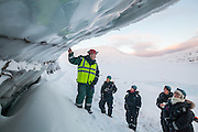 UNIS professor Doug Benn points out sediment-filled cracks to his students in the exposed glacier ice on Tellbreen, Svalbard.