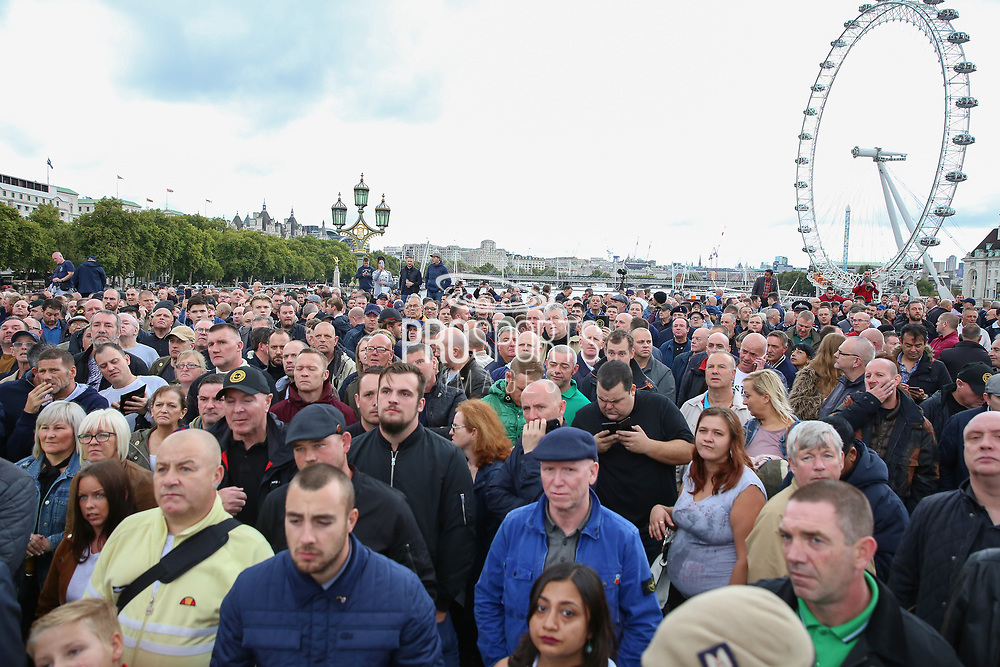 FLA supporters listen to speeches on Westminster Bridge during the Football Lads Alliance march between Park Lane and Westminster Bridge, London on 7 October 2017. Photo by Phil Duncan.
