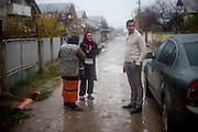 Portrait of local citizens in Zavraci (part of Marginenii de Jos) with Roma activists Marius Tudor on the right.