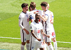 England's Raheem Sterling (centre) celebrates scoring their side's first goal of the game with team-mates during the UEFA Euro 2020 Group D match at Wembley Stadium, London. Picture date: Sunday June 13, 2021.
