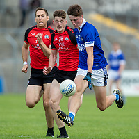 Cratloe's Diarmuid Ryan is chased by Clondegad's Brandon O'Connell and Gary Brennan