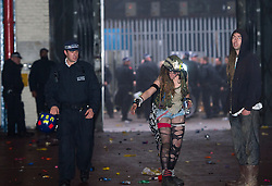 © Licensed to London News Pictures. 01/11/2015. London, UK. A policeman walks past to ravers inside the venue used for the rave. The scene where Riot police clashed with party goers at the site of an illegal halloween rave in London where it has been reported that a petrol bomb was thrown. Photo credit: Ben Cawthra/LNP