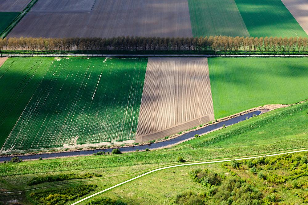 Nederland, Zeeland, Gemeente Terneuzen, 09-05-2013; Onder in beeld de Oostzeedijk, dijk van de Braakmanpolder. Paulinapolder met rij bomen aan de Havenstraat.<br /> Oostzeedijk (bottom pic), embankment of the Braakman Polder in Zeeland.<br /> luchtfoto (toeslag op standard tarieven)<br /> aerial photo (additional fee required)<br /> copyright foto/photo Siebe Swart