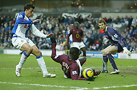 Photo: Aidan Ellis.<br /> Blackburn Rovers v Arsenal. The Barclays Premiership. 25/02/2006.<br /> Arsenal's kolo Toure denies Blackburn's Sergio Peter from getting a shot on goal