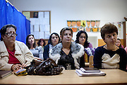 Teachers listening to a speech of Marius Tudor and Marian Daragiuin at the school in Marginenii de Jos.