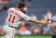 ATLANTA, GA - AUGUST 30:  Third baseman Ryan Zimmerman #11 of the Washington Nationals makes a play on a ground ball during the game against the Atlanta Braves at Turner Field on August 30, 2011 in Atlanta, Georgia.  (Photo by Mike Zarrilli/Getty Images)