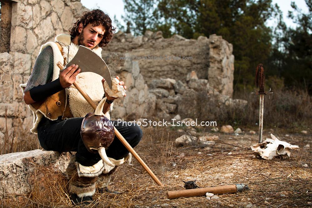A wild Barbarian Sharpens his war axe