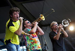 04 May 2012. New Orleans, Louisiana,  USA. .New Orleans Jazz and Heritage Festival. .Bonerama, a brass funk rocker band from New Orleans. Mark Mullins (yellow shirt), Greg Hicks (tie dye) and Craig Klein black shirt)..Photo; Charlie Varley.