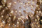 Curiosity Cloud by mischer'traxler, for Perrier-Jouet in the Music Room - The London Design Festival comes to the V&A with a range of installations including: Zotem, supported by Swarovski, is an 18m tall double-sided monolith created by young Norwegian designer Kim Thomé; The Cloakroom by Faye Toogood, where visitors are invited to take one of 150 coats to wear as they explore the Museum using a sewn-in fabric map to guide them to discover 10 different coat sculptures; Curiosity Cloud by mischer'traxler, for Perrier-Jouet in the Music Room, in which 250 mouth-blown glass globes hang from the ceiling containing a single, hand-made insect; and The Ogham Wall, by Grafton Architects for Irish Design 2015, in which 23 'fins' (resembling Irish and British standing stones) carry an ancient alphabet which originated deep in Irish Celtic history. The annual festival runs from 19 – 27 September, and the Victoria and Albert Museum is the Festival's hub - www.londondesignfestival.com