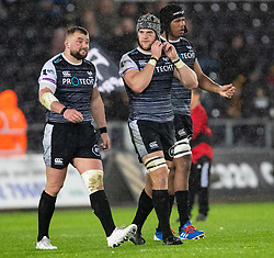 Dan Lydiate of Ospreys with team-mate  Sam Parry and Marvin Orie<br /> <br /> Photographer Simon King/Replay Images<br /> <br /> Guinness PRO14 Round 6 - Ospreys v Connacht - Saturday 2nd November 2019 - Liberty Stadium - Swansea<br /> <br /> World Copyright © Replay Images . All rights reserved. info@replayimages.co.uk - http://replayimages.co.uk