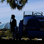 'A Day at the Polo'<br /> A man smokes a cigarette near a vintage car parked near the competition field during the International Polo Test match between Australia and England at the Windsor Polo Club, Richmond, Sydney, Australia on March 29, 2009. Australia won the match 8-7.  Photo Tim Clayton