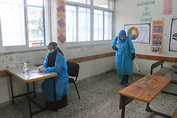 March 18, 2020, Nuseirat Refugee Camp, The Gaza Strip, Palestine: Palestinian workers disinfect UNRWA school at Nuseirat refugee camp  in central of the Gaza Strip. (Credit Image: © Mahmoud Khattab/Quds Net News via ZUMA Wire)