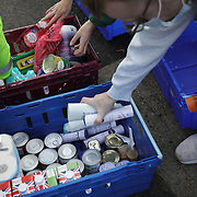 Workers and volunteers at Hackney Foodbank receive and organize food donations, 15th of December 2021, Hackney, East London, United Kingdom. Food donations ready to be distributed into food parcels.The Hackney Foodbank is part of a nationwide network of foodbanks, supported by The Trussell Trust, working to combat poverty and hunger across the UK. The food bank gives out three days emergency food supplies to families and individual who go hungry in the borrough. The food is all donated by individuals and the food donated is held in a small ware house where it is  sorted and packed for distribution.  More people than ever in Britain have turned to the food bank for help and in Hackney the need has gone up with 350% over the past two years.