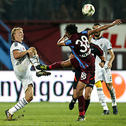 Fenerbahce's Dirk Kuyt (L) during their Turkish SuperLeague Derby match Trabzonspor between Fenerbahce at the Avni Aker Stadium at Trabzon Turkey on Sunday, 14 September 2014. Photo by Aykut AKICI/TURKPIX