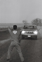 Superhero and car on road (B&W)