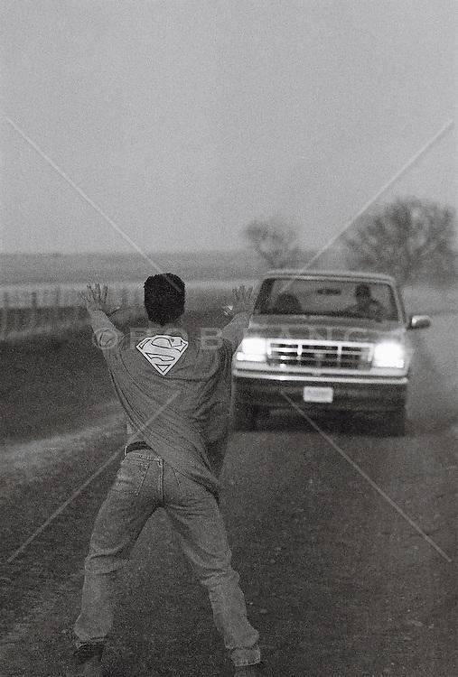 Superhero and car on road (B&W)