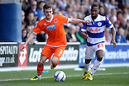 Blackpool's Jack Robinson goes past  Queens Park Rangers Junior Hoilet .Skybet football league championship match , Queens Park Rangers v Blackpool at Loftus Road in London  on Saturday 29th March 2014.<br /> pic by John Fletcher, Andrew Orchard sports photography.