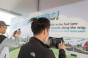 Attendees play on augmented reality at the AARP Block Party at the Albuquerque International Balloon Fiesta in Albuquerque New Mexico USA on Oct. 7th, 2018.
