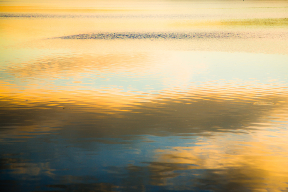 The sunset coloured sky reflected off an area of the Pumicstone Passage, Bribie Island National Park.