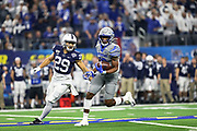Memphis Tigers wide receiver Kedarian Jones (13) catches a deep pass against cornerback John Reid (29) of the Penn State Nittany Lions during the game of the NCAA Cotton Bowl Classic football game, Saturday, Dec. 28, 2019 at AT&T Stadium in Arlington, Texas. Penn State defeated Memphis 53-39. (Mario Terrana/Image of Sport)
