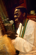 Josè Galissa is a griot, a traditional musician  born in Guinèe Bissau. The instrument is a traditional Korà.