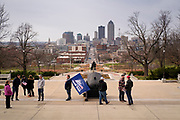 """21 NOVEMBER 2020 - DES MOINES, IOWA: People walk past the front of the Iowa State Capitol with downtown Des Moines in the background before a """"Stop the Steal"""" rally. About 100 supporters of US President Donald Trump gathered at the Iowa State Capitol to rally in support of the President and in opposition to the outcome of the US election. They are a part of the """"Stop the Steal"""" movement which has spread across the US. This is the third week that there have been """"Stop the Steal"""" rallies across the US. Most independent observers and election officials, both Republican and Democratic, have said the election was free and fair and that there was no election fraud.     PHOTO BY JACK KURTZ"""