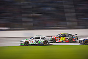 Kyle Busch (18) battles Jeff Gordon (24) for the lead of the Sprint Cup NRA 500 at Texas Motor Speedway in Fort Worth on Saturday, April 13, 2013. (Cooper Neill/The Dallas Morning News)