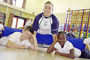 Olympic Gymnast, Danile Keeating visits his old school of Daneholme Juniors in Corby...l-r, Joe Martin, 10, Daniel Keating, Mellissa Shiundu,10