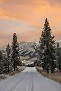 Open Edition Numbered Prints Boulder Mountains with morning sunrise in Central Idaho and single car tracks going down road