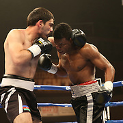 """Simeon Hardy (right) fights against Rahman Yusubov during the undercard bout of the ESPN """"Boxcino"""" boxing tournament at Turning Stone Resort Casino on Friday, April 18, 2014 in Verona, New York.  (AP Photo/Alex Menendez)"""