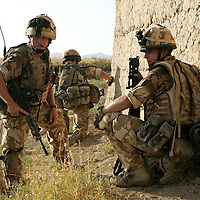 6th July 2007.Kajaki, helmand Province, Afghanistan.Soldiers of 1 Royal Anglian C Coy move through a series of compounds searching them in order to flush out Taliban fighters who have been using the locations as firing positions. The enemy were spotted and engaged, they fired RPG's (rocket propelled grenades) and other small arms at the British troops. Kajaki, Helmand Province, Afghanistan, 6th July 2007.