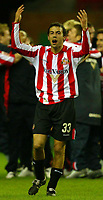 Photo: Chris Brunskill. Wigan Athletic v Sunderland. Coca-Cola Championship. 05/04/2005. Julio Arca of Sunderland celebrates victory at the end of the game