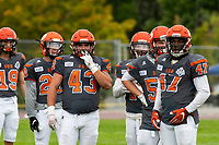 KELOWNA, BC - SEPTEMBER 22:  Tyler Going #20, Will Kuyvenhoven #43, and Miguel Wood #47 of Okanagan Sun stand on the field against the Valley Huskers at the Apple Bowl on September 22, 2019 in Kelowna, Canada. (Photo by Marissa Baecker/Shoot the Breeze)