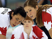 Canada's Jill Officer (left to right), Dawn McEwen and Kaitlyn Lawes watch a throw during their victory over Great Britain in the women's curling semifinals at the Ice Cube Curling Center during the Winter Olympics in Sochi, Russia, Wednesday, Feb. 19, 2014. (Brian Cassella/Chicago Tribune/MCT)