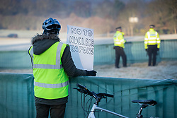 © Licensed to London News Pictures. 04/12/2019. Watford, UK. A lone protestor stands in an area designated for demonstrators near the gates to The Grove Hotel where NATO leaders are meeting. World leaders are attending a series of events over the two day NATO summit which will mark the 70th anniversary of the alliance of nations. Photo credit: Peter Macdiarmid/LNP